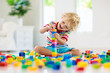canvas print picture Child playing with toy blocks. Toys for kids.