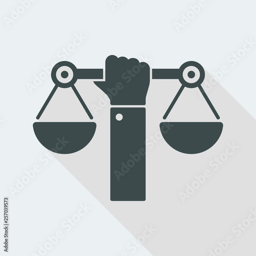 Valokuva Hand holding a balance symbol of justice