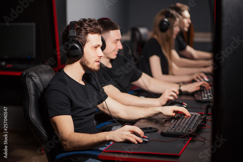 Fényképezés Casual gamers and hardcore fans are gather together in pc gaming club to compete