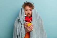 Photo Of Ill Bearded Man Wrapp...