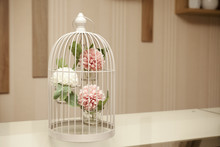 White Birdcage With Flowers Inside