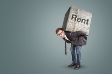 Conceptual Image Of A Man Burdened By High Rent