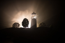 Lighthouse With Light Beam At ...