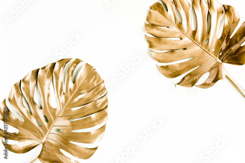 Wall Murals Floral Gold tropical palm leaves Monstera on white background. Flat lay, top view minimal concept.