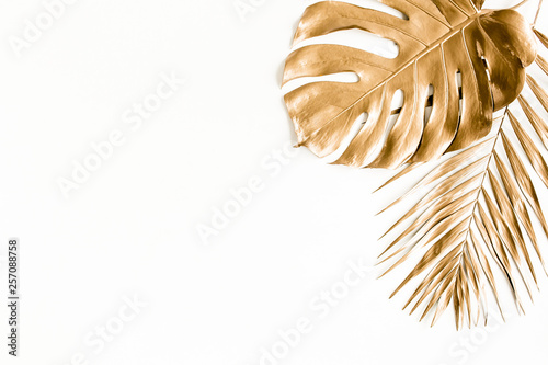 Wall Murals Floral Gold tropical palm leaves on white background. Flat lay, top view minimal concept.