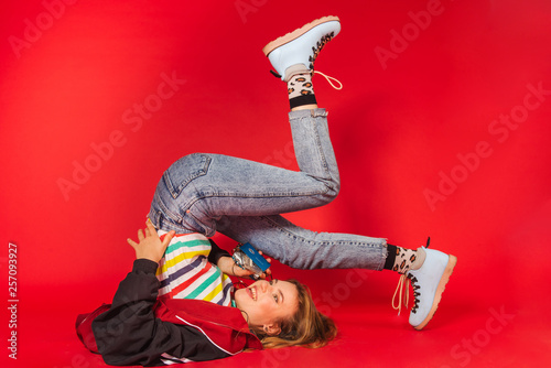 Young blonde girl in 90s retro style clothes - 257093927