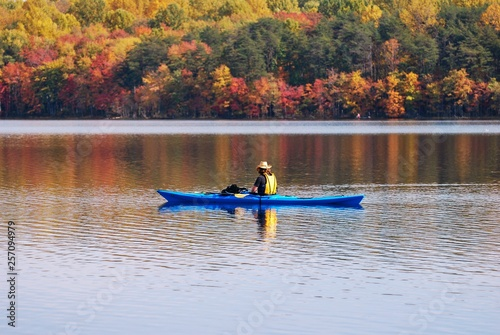 Fotografie, Obraz  Kayaking in Lake with reflection of fall leaves.