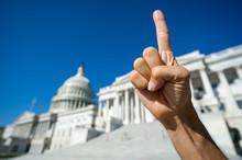 Hand Of A Proud America First Protestor Gesturing With A Single Index Finger Pointing Skyward In Front Of The Capitol Building In Washington, DC, USA