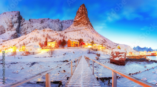 Picturesque panorama of Reine fishing village on Lofoten islands in Norway, Scandinavia, Europe. Reine is famous and most popular northern travel destination over polar circle on Lofotens.