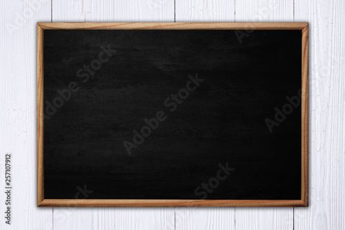 Abstract blackboard or chalkboard with frame on wooden background.