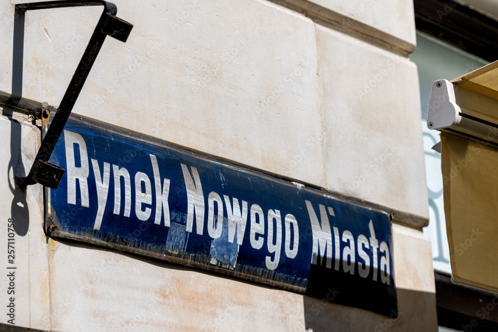 Fototapety, obrazy: Warsaw, Poland New town historic road during sunny summer day morning with closeup of street sign and text for Rynek Nowego Miasta in Polish