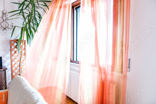 Foto Colorful orange open window curtains blinds in room interior indoors apartment f