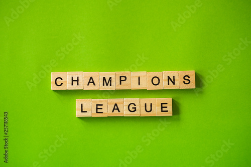 Fotografia, Obraz  The word CHAMPIONS LEAGUE shot flat lay on a green isolated background
