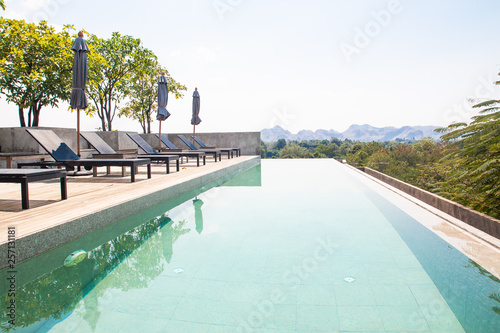 Kanchanaburi Thailand February 20 2019 Modern And Simply Design Chaise Lounge And Swimming Pool On The Hotel Roof Top With Mountain View Buy This Stock Photo And Explore Similar