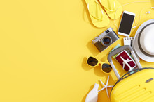 Flat Lay Yellow Suitcase With Traveler Accessories On Yellow Background. Travel Concept. 3d Rendering