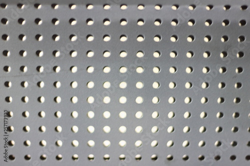 Valokuva Perforated metal sheet - texture for industrial background
