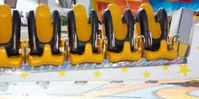 Seats Of A Spinning Fun Fair Amusement Ride