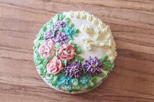 Tasty Big Cake Decoreted With Cream Roses Close-up