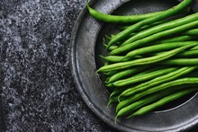 Green Beans On The Dark Background Isolated