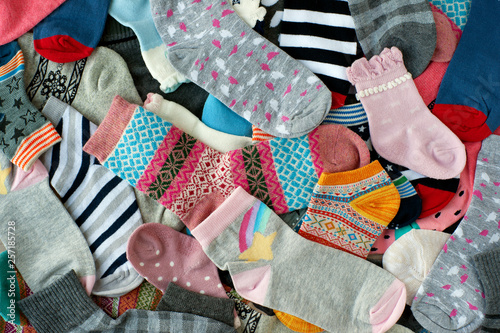 A pile of socks of different colors. Many socks of different ...