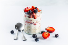 Overnight Oats With Chia Seeds And Fresh Strawberries And Blueberries In A Glass Jar. Healthy Breakfast.