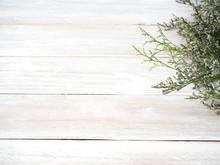 Purple Limonium Flowers On White Wooden Background