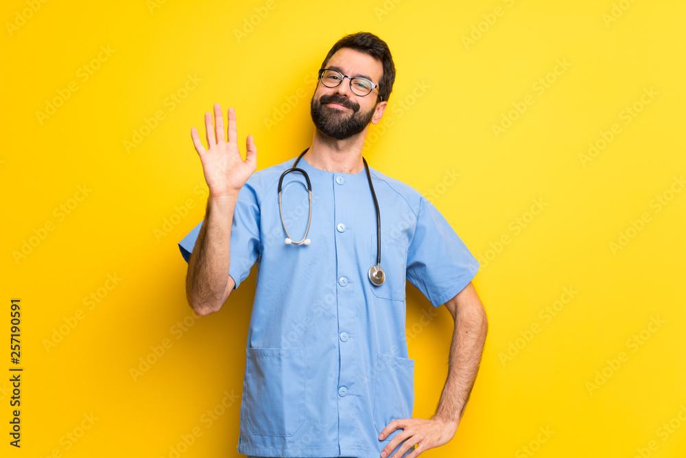 Fototapety, obrazy: Surgeon doctor man saluting with hand with happy expression