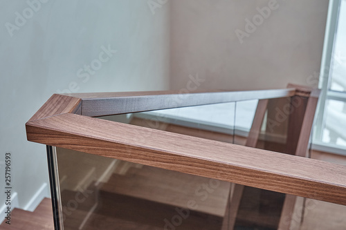 Fotografiet Part of wooden steps with glass railings. Walnut staircase