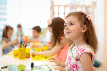 Group Of Preschool Kids Engaged In Drawing And Crafts