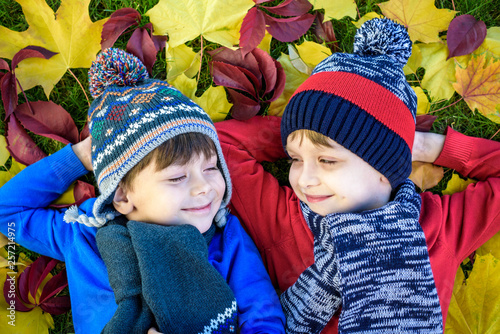015ac85ae73 Happy siblings having fun in autumn park on warm day. Healthy children  scarf and hat with maple ... See More