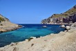 Sea bay with turquoise water, beach and mountains, Cala Figuera on Cap Formentor