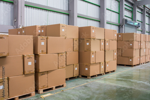 Fototapeta Rows of material boxes or product boxes in warehouse area. obraz