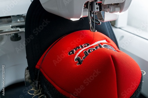 Embroidered cap and embroidery machine close up image Wallpaper Mural