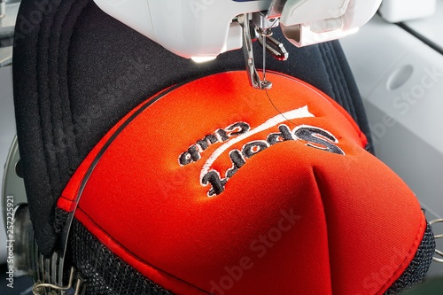 Close up picture of red cap on the hoop of embroidery machine Canvas Print