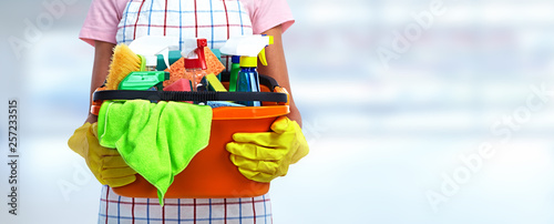 Valokuva  Hands with bucket of cleaning products.
