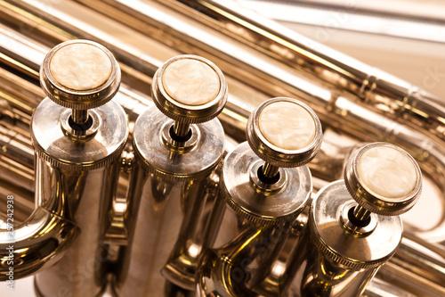 Photo Fragment of a bass tuba valves closeup