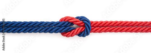Obraz Czerwona i niebieska linka związane na białym tle - fototapety do salonu