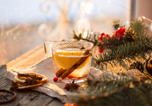 Winter Theme. Christmas Tea With Spices, Cup Of Tea With Orange, Cinnamon, Anise, Cookies In A Shape Of Star, Pepper And Gray Scarf On Wooden Background. Flat Lay, View From Above. Copy Space For Text