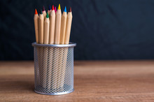 Crayons In The Metal Holder
