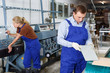 Male glazier working in glass factory
