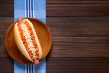 Chilean Completo Clasico (classical) Or Completo Aleman (German) Traditional Hot Dog Sandwich, Made Of Bread, Sausage, Tomato Cubes And Sauerkraut, Photographed Overhead