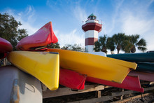 Colorful Kayaks In Front Of A ...