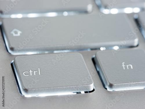 Poster Macarons Ctrl - Control key on silver laptop keyboard. Close up