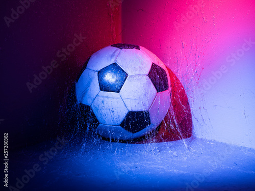 Fototapety, obrazy: soccer ball in the corner with blue and red lights and spider net.