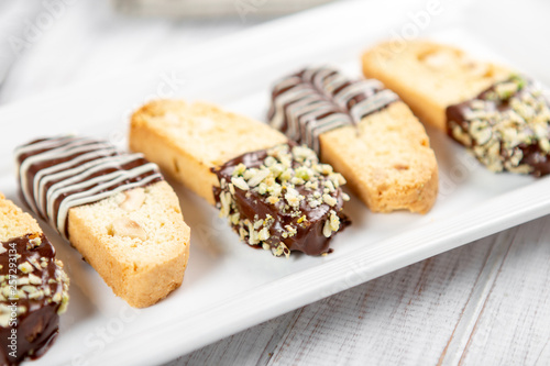 Slika na platnu Cantuccini biscuits with chocolate and pistachios