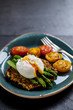 Courgette rosti, poached egg, asparagus and roast tomatoes