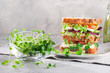canvas print picture - Microgreens sprouts of radish and cress in glass bowl near homemade sandwich