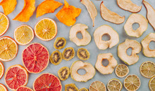 Mixed Dried Fruits And Vegetables Slices On White Background