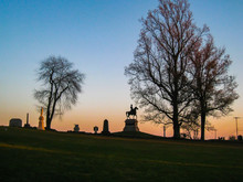 Gorgeous Sunset Silhouetting Statues At Gettysburg National Park, Pennsylvania (USA).
