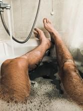 Man Lying In A Bath Tub